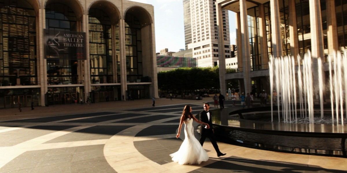 Wedding couple walking in Lincoln Center